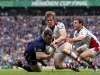 Rugby Union - ERC Heineken Cup Final - Leinster vs. Ulster  Cian Healy of Leinster is tackled by Andrew Trimble and Craig Gilroy of Ulster at Twickenham, London